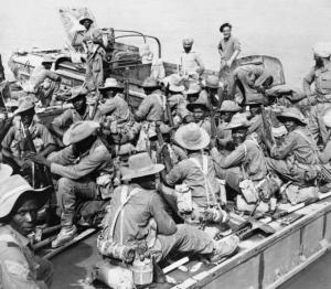 Soldiers_of_the_11th_East_African_Division_crossing_the_River_Chindwin_by_ferry_before_moving_towards_the_village_of_Shwegyin,_Burma,_December_1944._SE923